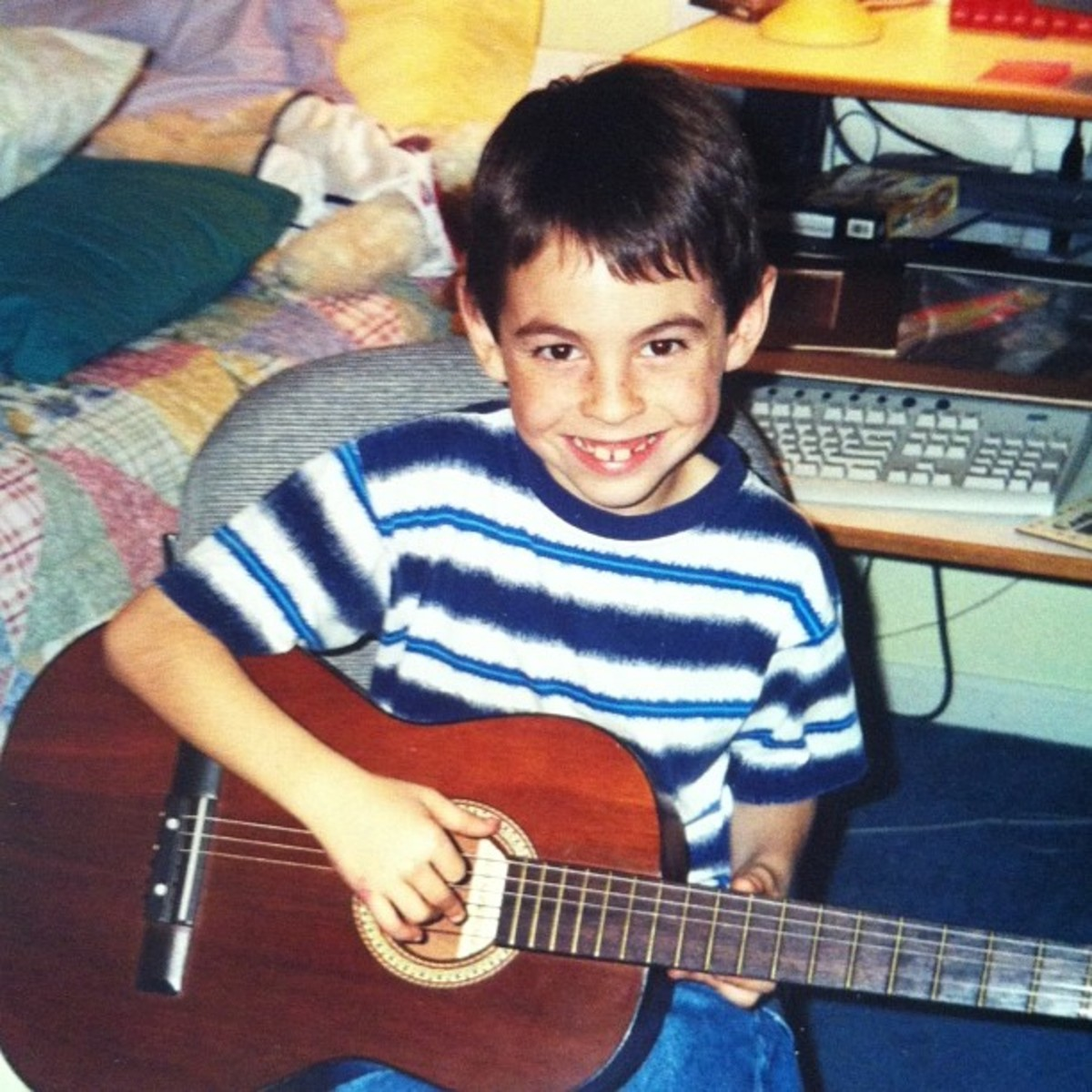 my little brother playing his guitar back in the day