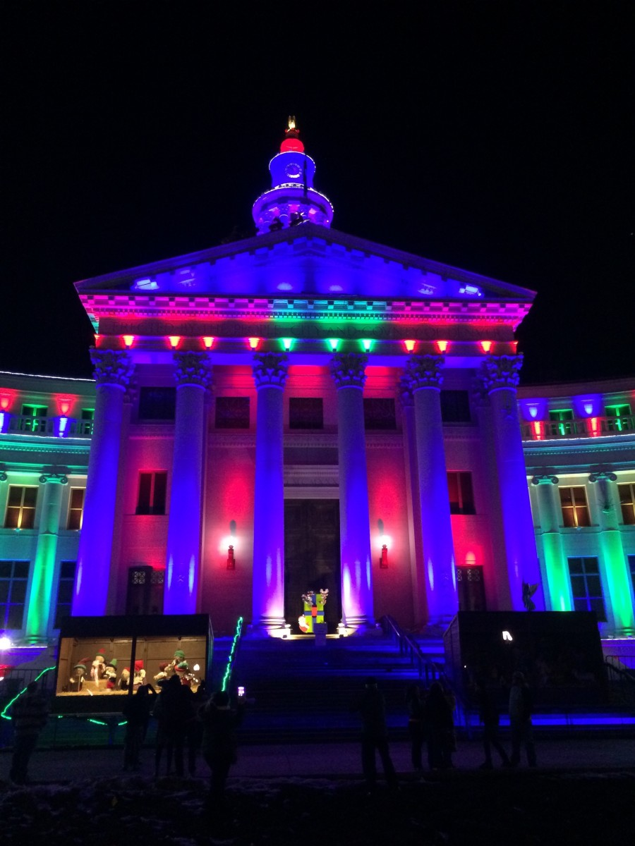 This is a photo of the middle section of the City & County Building with holiday lights.