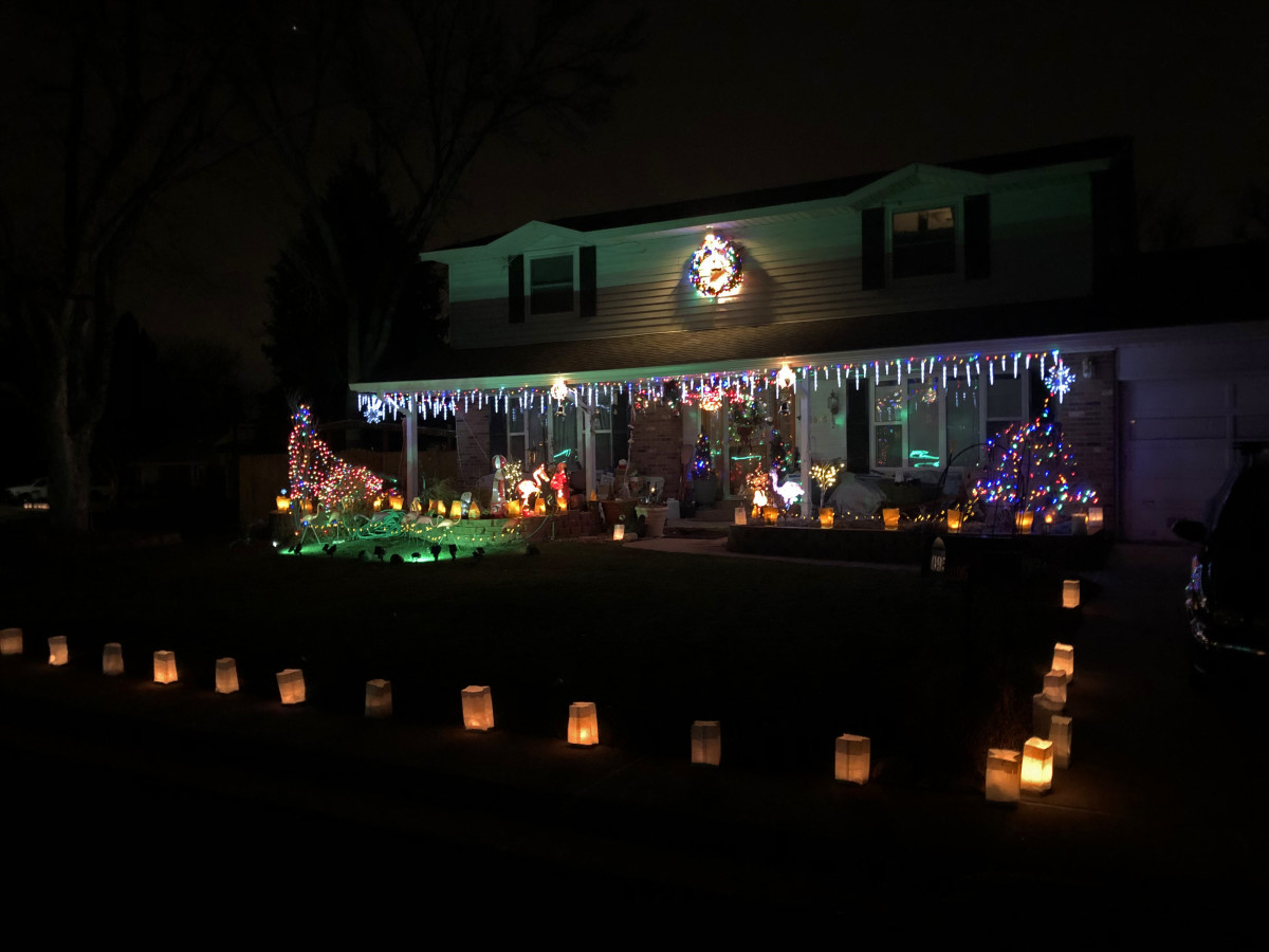 Luminaria and Christmas lights in Littleton neighborhood.