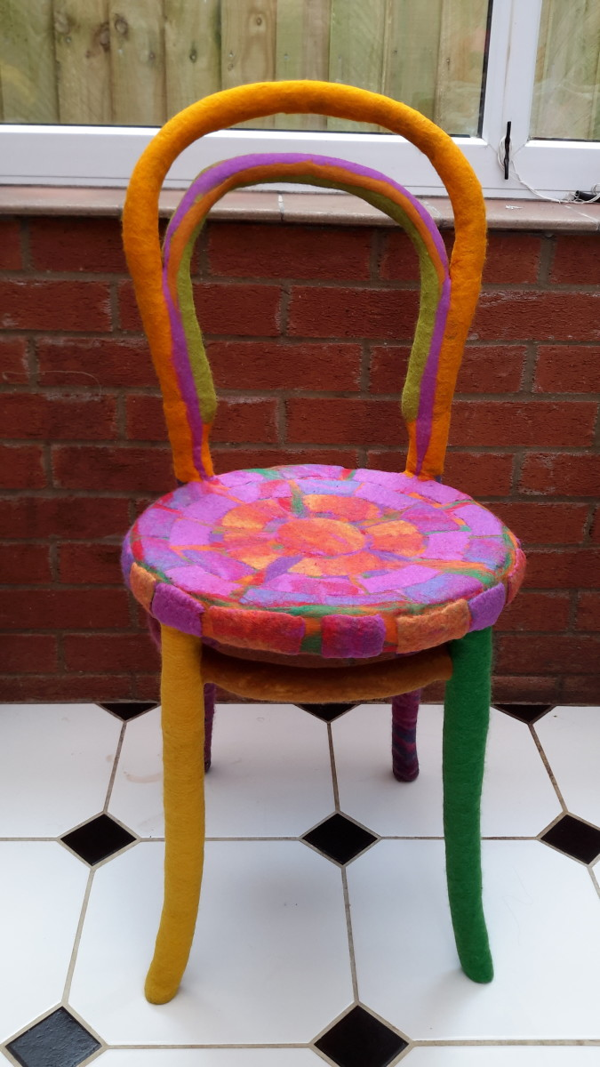 The completed chair which has been covered in merino roving.