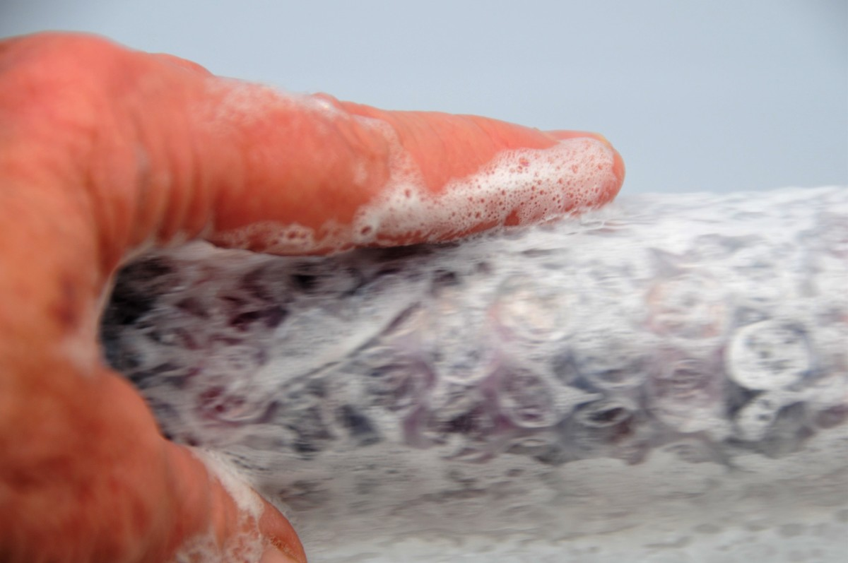 Rubbing the fibers with wet fingers.