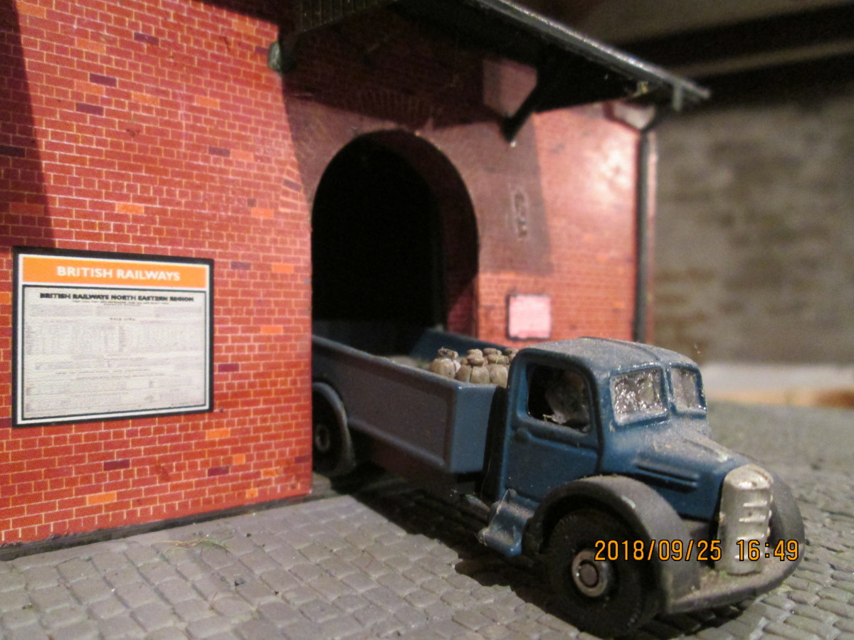 A lorry has backed in to the goods shed - notice beside the arched doorway warns of impending closure