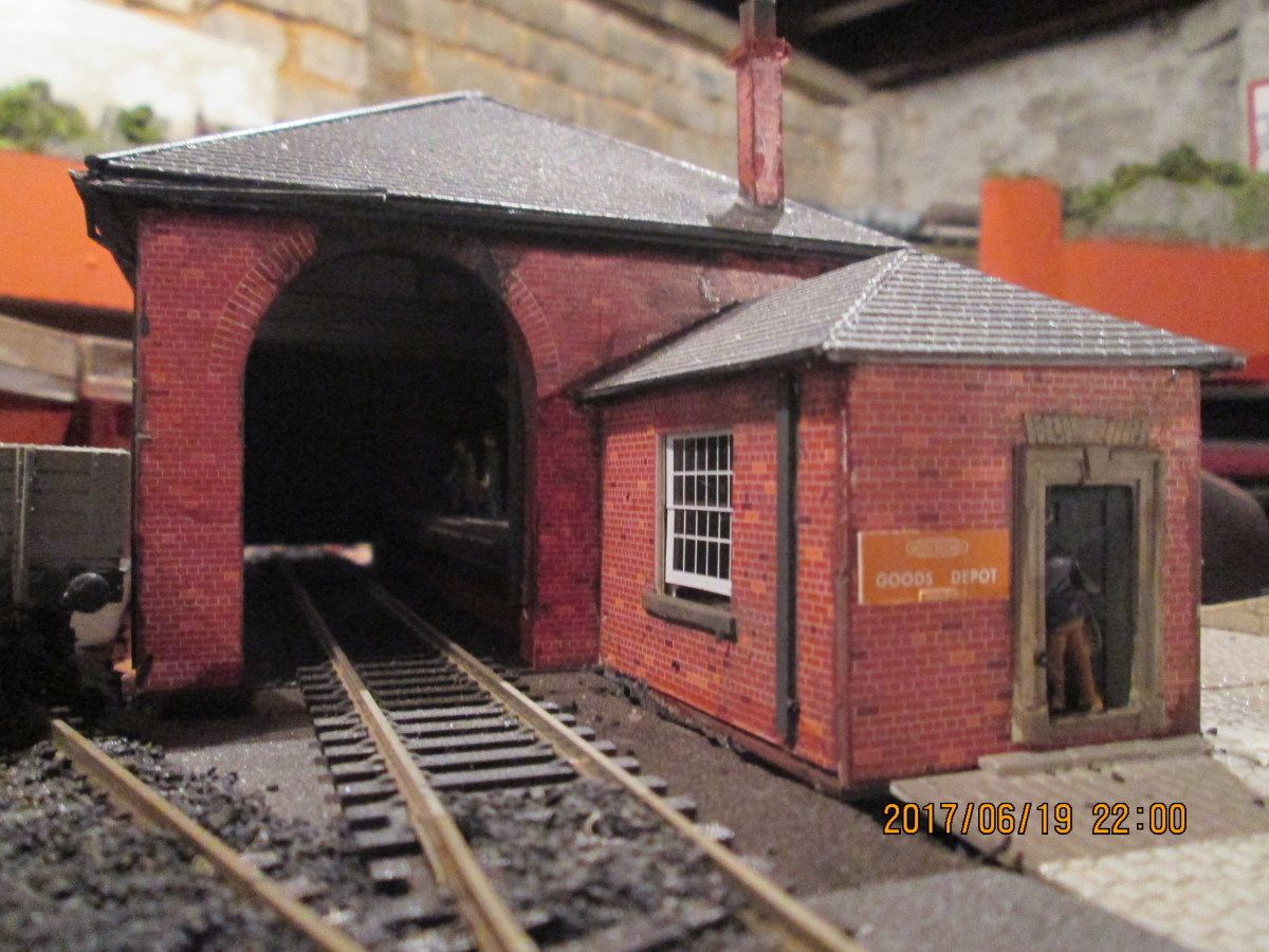 This is where the wagon weighbridge will be added, in front of the large - slightly ajar - window of the office. Balsa was added and painted to improve the appearance of the window sill