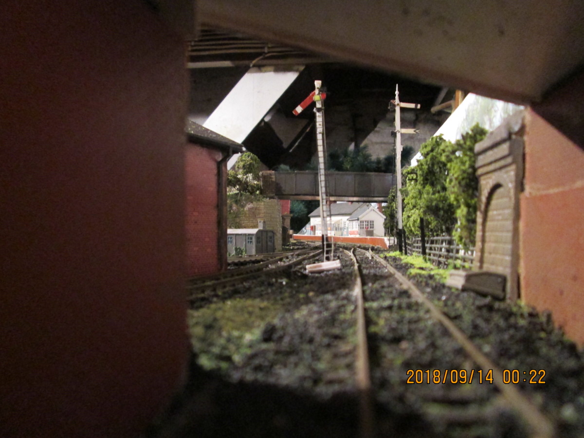 View down the tracks with the platform road free - seen from under the public (narrow) bridge