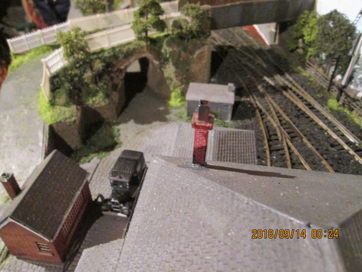 Bird's eye view over goods shed shows cab's on its wayr. Note vegetation and picket fencing added. Still some to add on the ramps, as well as a loading gauge and platform water crane. Soon be complete, then it's hi-ho, hi-ho to add the fiddleyard
