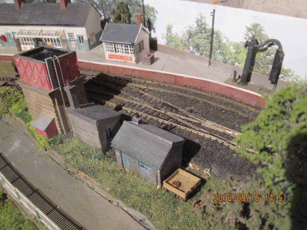 Look the other way for the general arrangement of the station side of the diorama. Telegraph poles painted, vegetation in place, buildings and bridges sited. Only the LNER loading gauge and ground signals to be painted and put in place