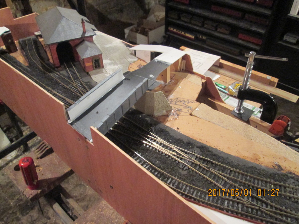 Bird's eye view of the girder bridge from the back, shows the ramp at the front of the layout that leads down to the goods depot.