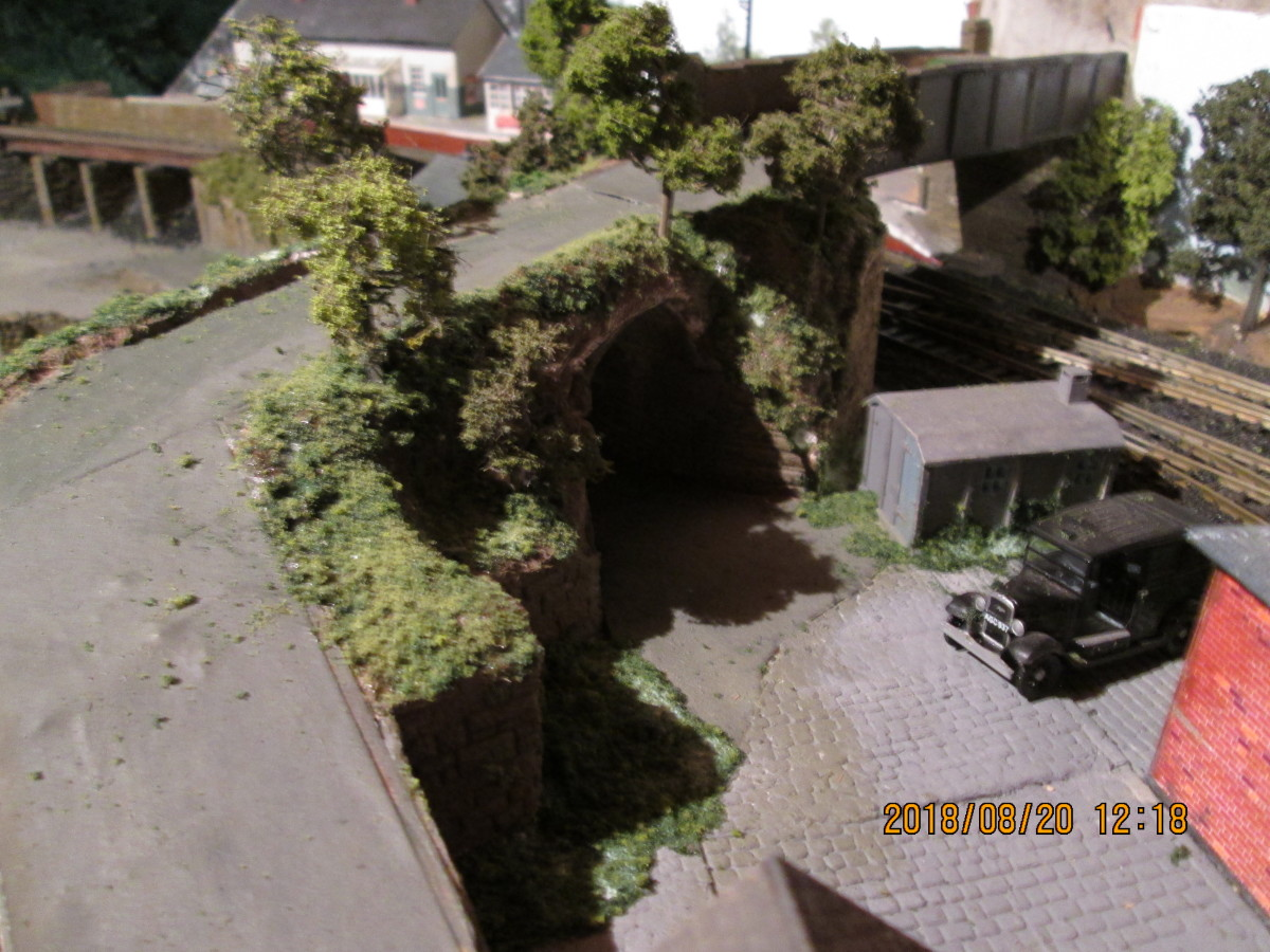 The goods depot side of the occupation bridge approach has witnessed dramatic changes, with  vegetation added beside the ramp and around the post-WII concrete gangers' hut.  A few fences and railings are needed around the site to complete the picture