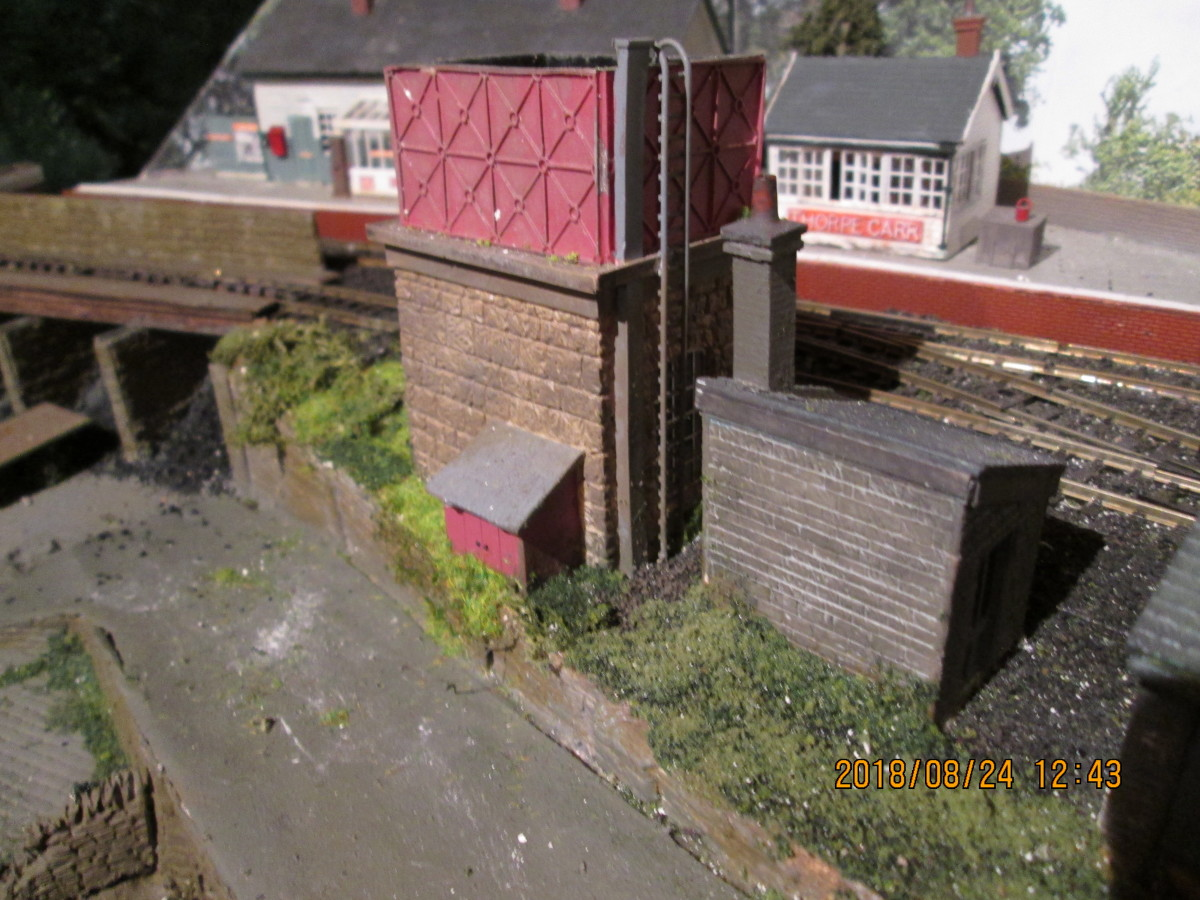 Nearly forgot - added a water tower. Knew there was something missing. A water crane for the platform should complement it, when I can find one that I stripped from 'Thoraldby' before it was taken away (for a new life as a Buckinghamshire station).