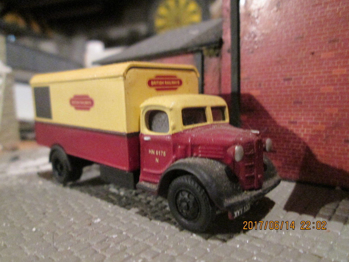 Again in early B R livery, a heavy goods delivery/collection van pauses outside the goods shed