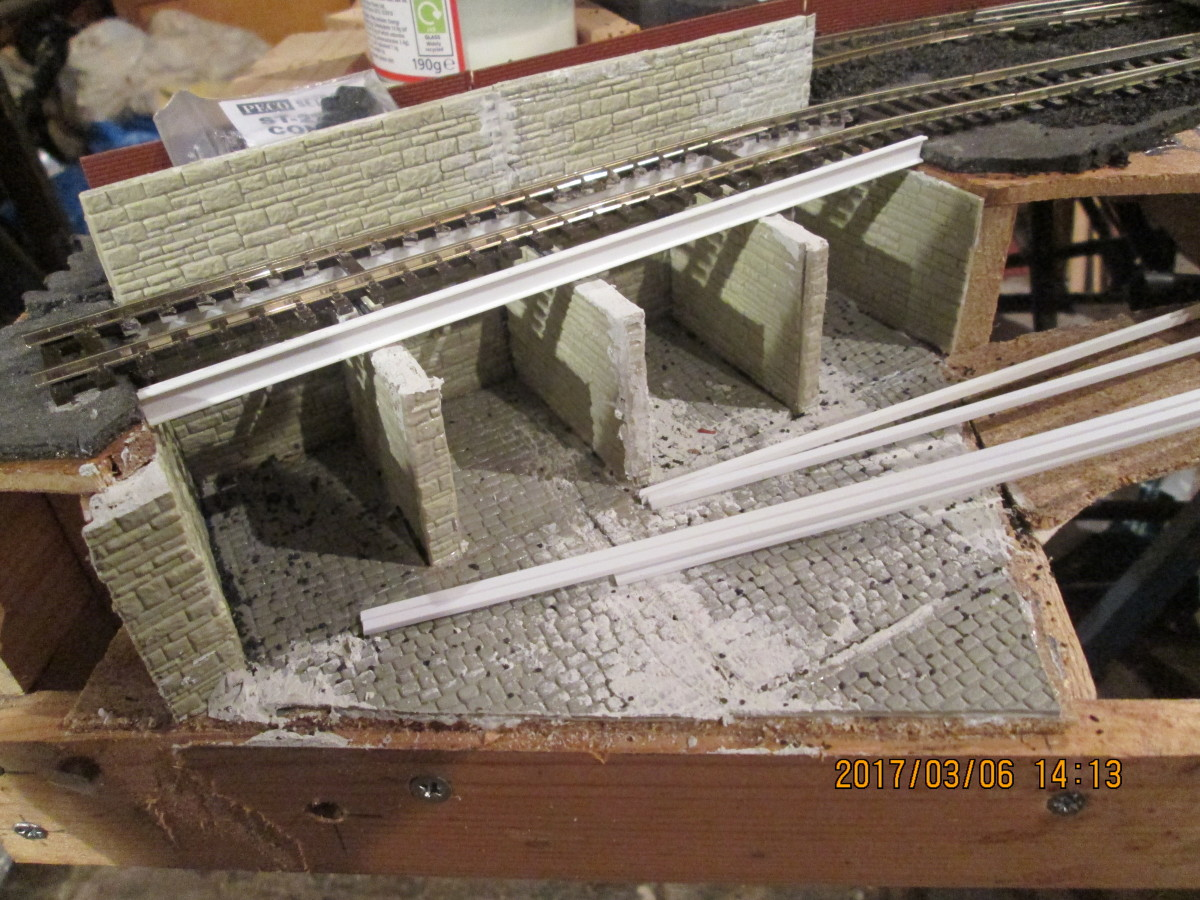 Coal depot takes shape. Track fixed down against the back support to allow space for gangway timbering. Struts along the tops of the cell walls will separate cells and support intermediate sleepers. Front ribbing to follow