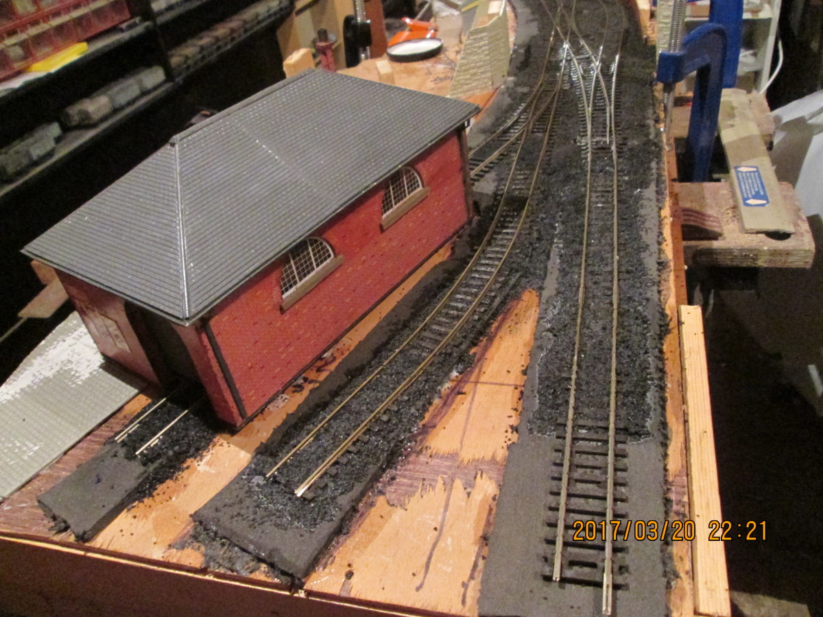 The track on the right will be covered by another road after the Peco power clips have been added, and 'bled off' to fiddle yard. Centre is the wagon headshunt, left the 'stub' at the goods shed's back door.