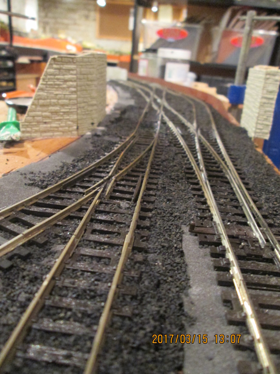 Ballasting done past the pointwork on the 'Up' end  At left is the way into the goods shed where a wagon weigh bridge should be added in front of the office window. Centre is the shunt road, right is the 'Up' road out (probably under a skew bridge)