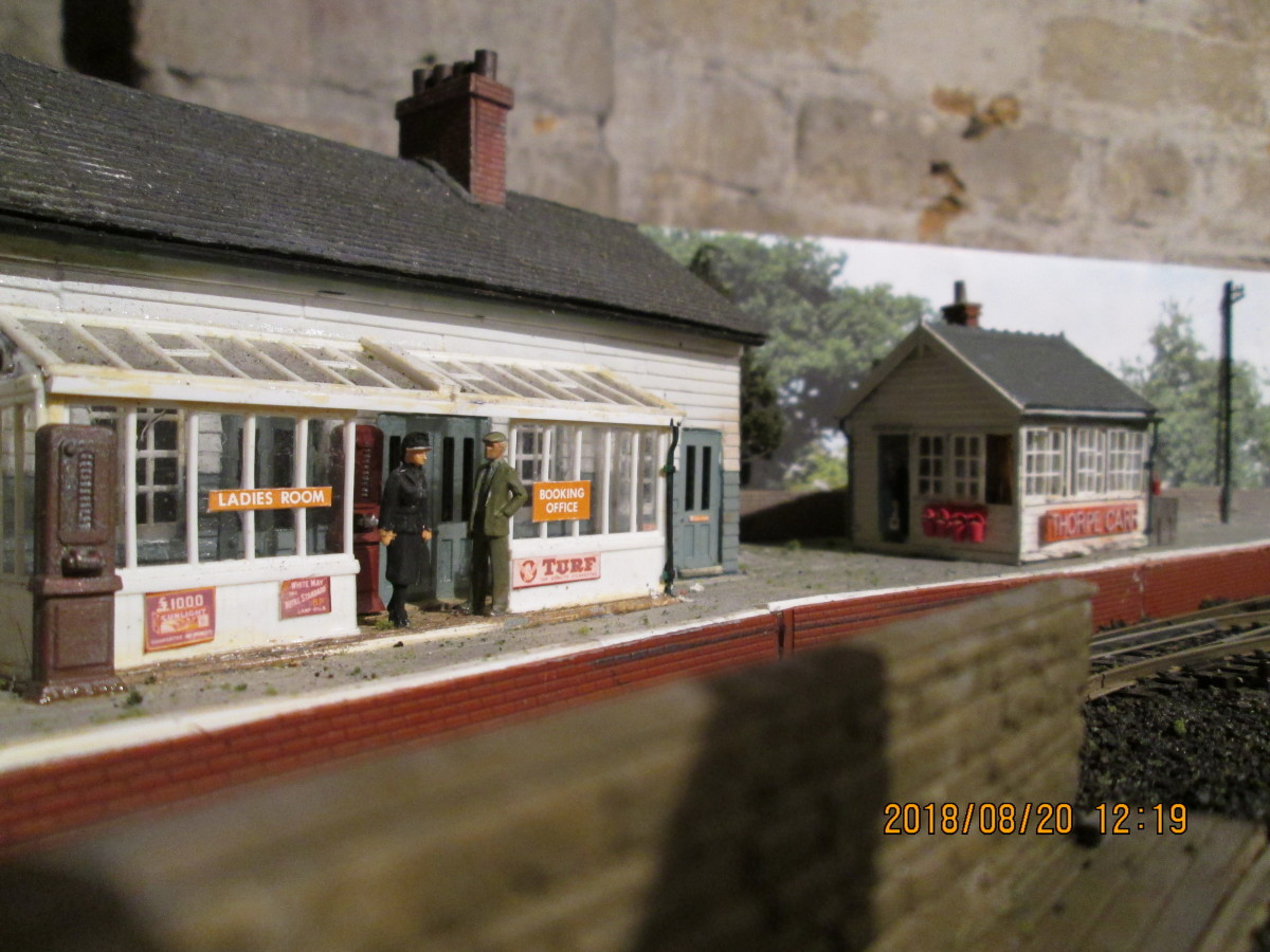 Station offices and waiting room with reinstated signal cabin. In the foreground is the coal depot wall to stop coal dust being blown onto passengers - a consideration witnessed across the region where coal depots were close to passenger facilities