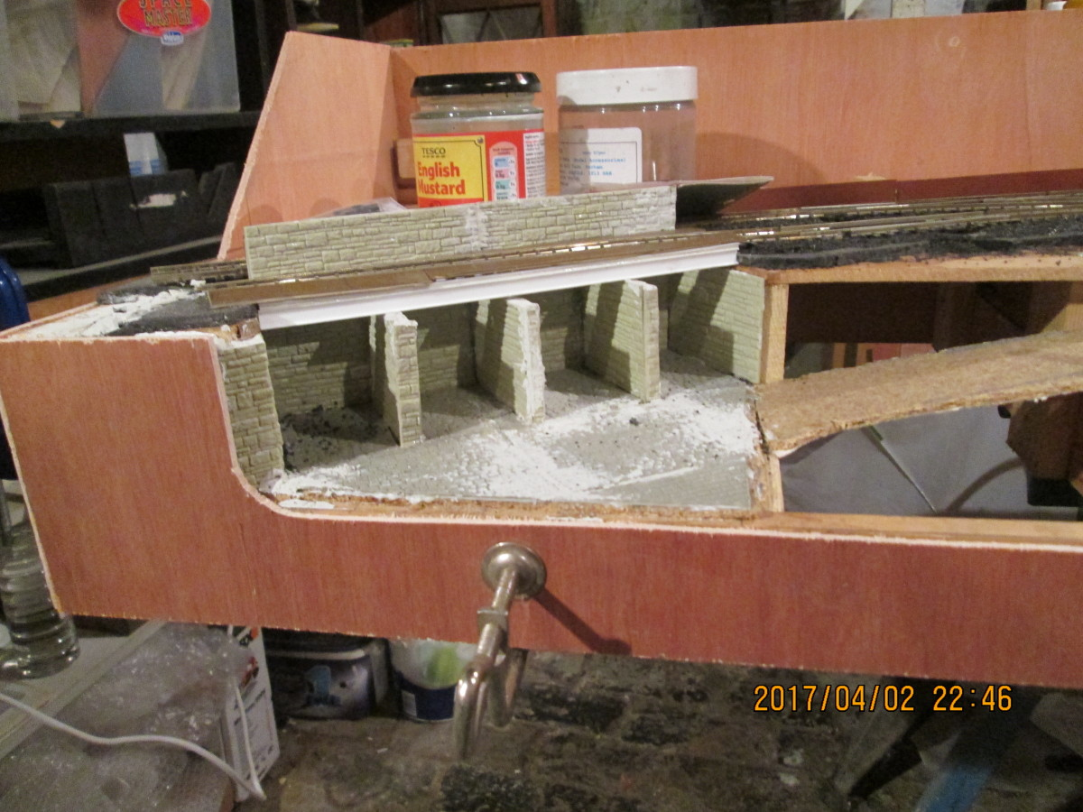 Close-up of the coal depot corner, with the casing cut out to ground level and modelled around the end wall - the gap here also to be filled in.
