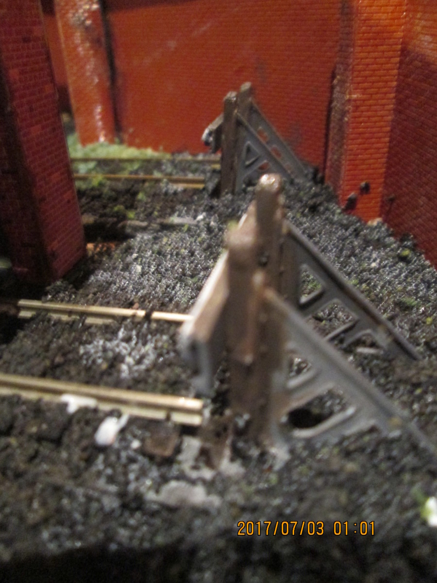 Embedded in ash ballast, the two goods depot buffer stops. Work yet to do...