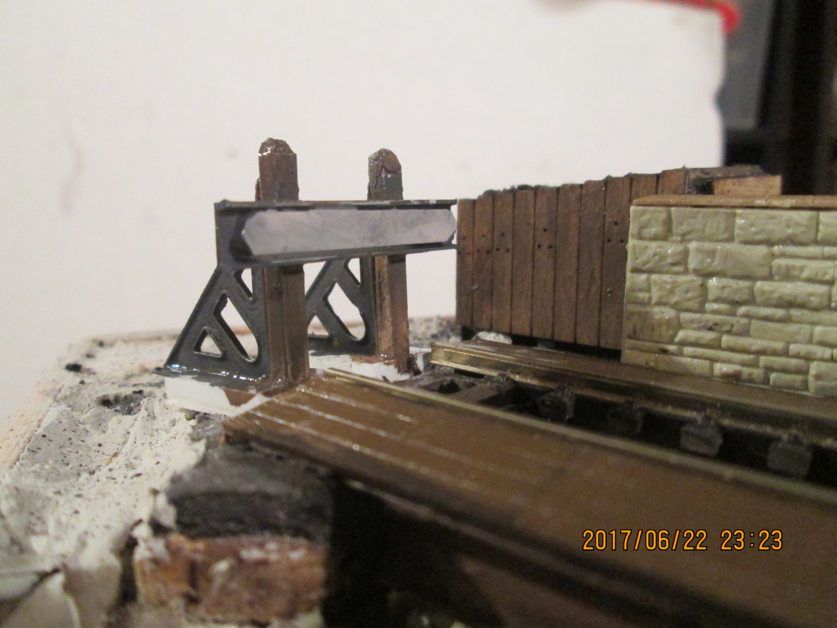 The end of the line... One of the pairs of cast brass North Eastern Railway style buffer stop sides from Slaters now completed, with plastic posts and beam from the Evergreen strip styrene range... seen from from front