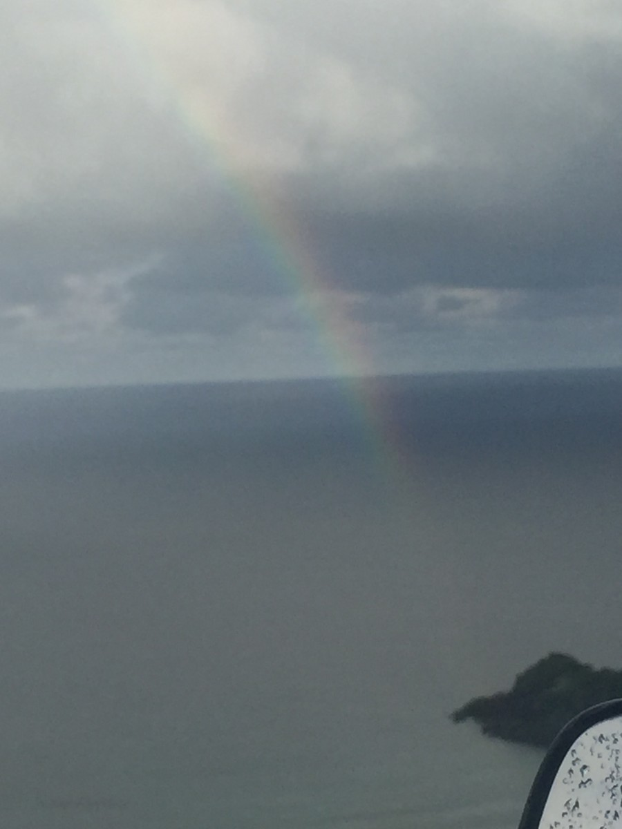 Captured this magnificent rainbow on December 3, 2017 @ 7:52am, westward side of St. Thomas, Puerto Rico is far in the background. Ocean bow!