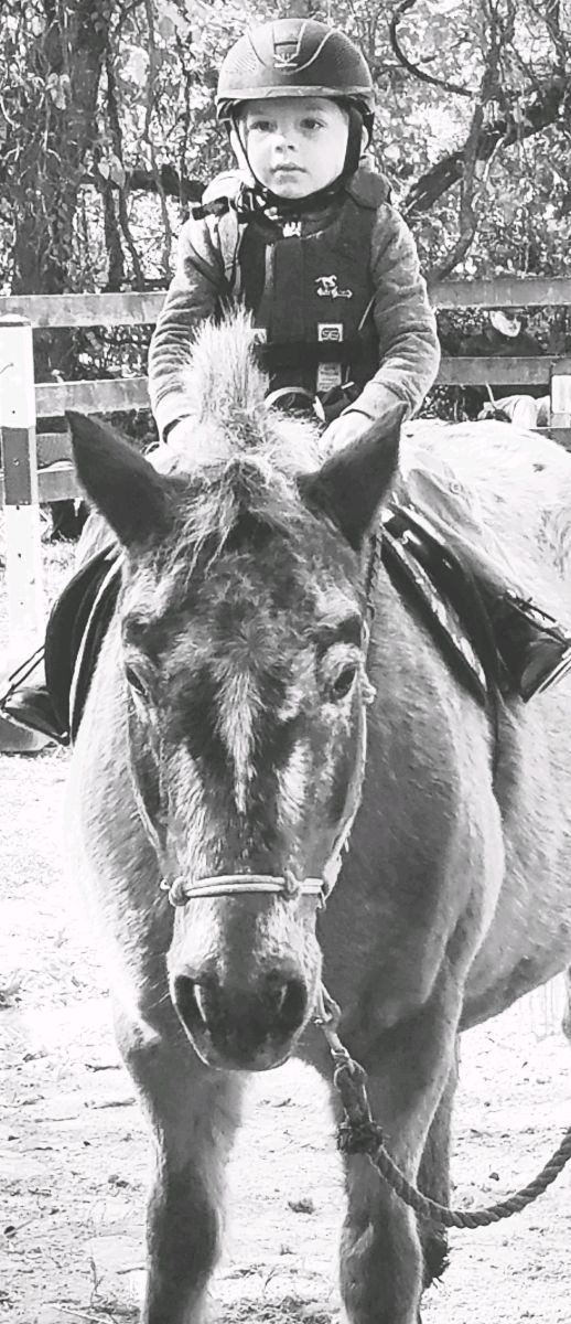 """How young is too young for a child to start riding lessons? This is my nephew, age 3 1/2 at the time. He is not in lessons yet, but being in a """"horsey family"""" he has had a lot of time in the saddle for his age."""