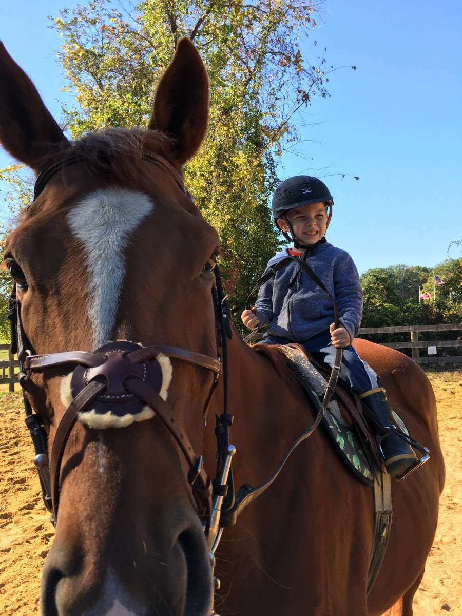 """Oliver """"riding"""" his mommy's horse Cool."""