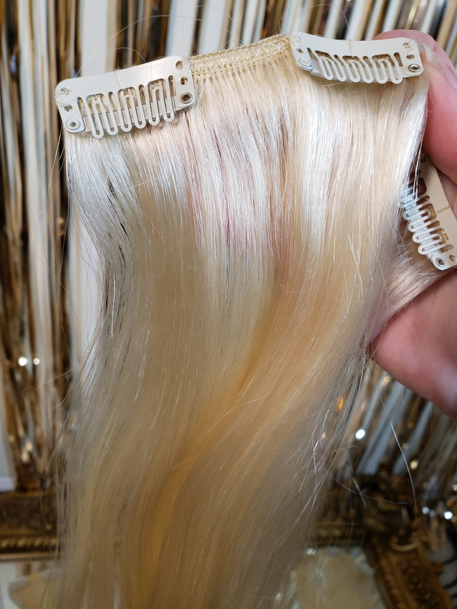 Clip-in human hair extensions. They're super soft, styleable, and need some TLC to stay that way.