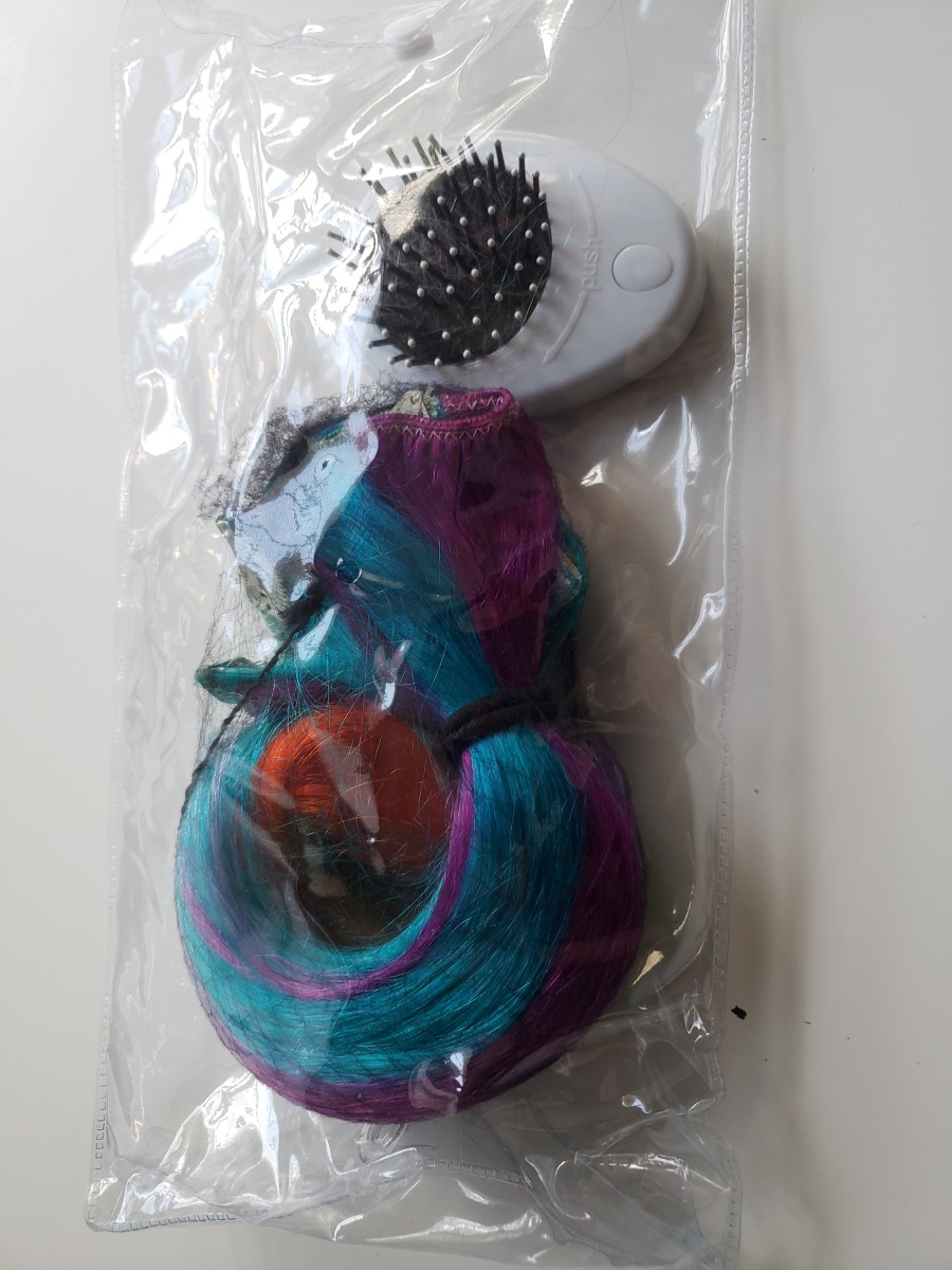 Extensions wrapped in a hair net and stored in a dry bag
