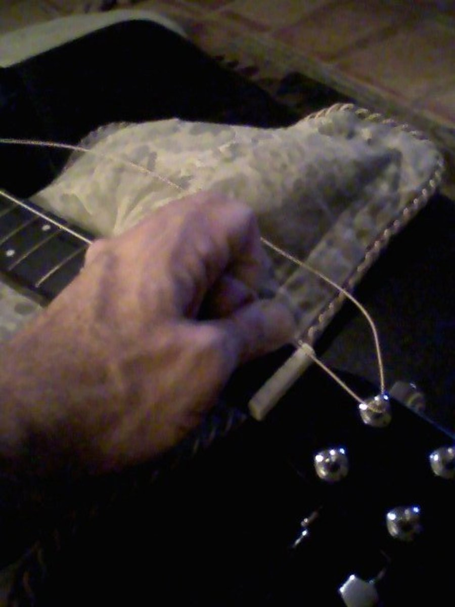 As you wind the string tight--I prefer not to use the winder for this--it's important to keep tension on the string, both on the peg side and on the bridge side.