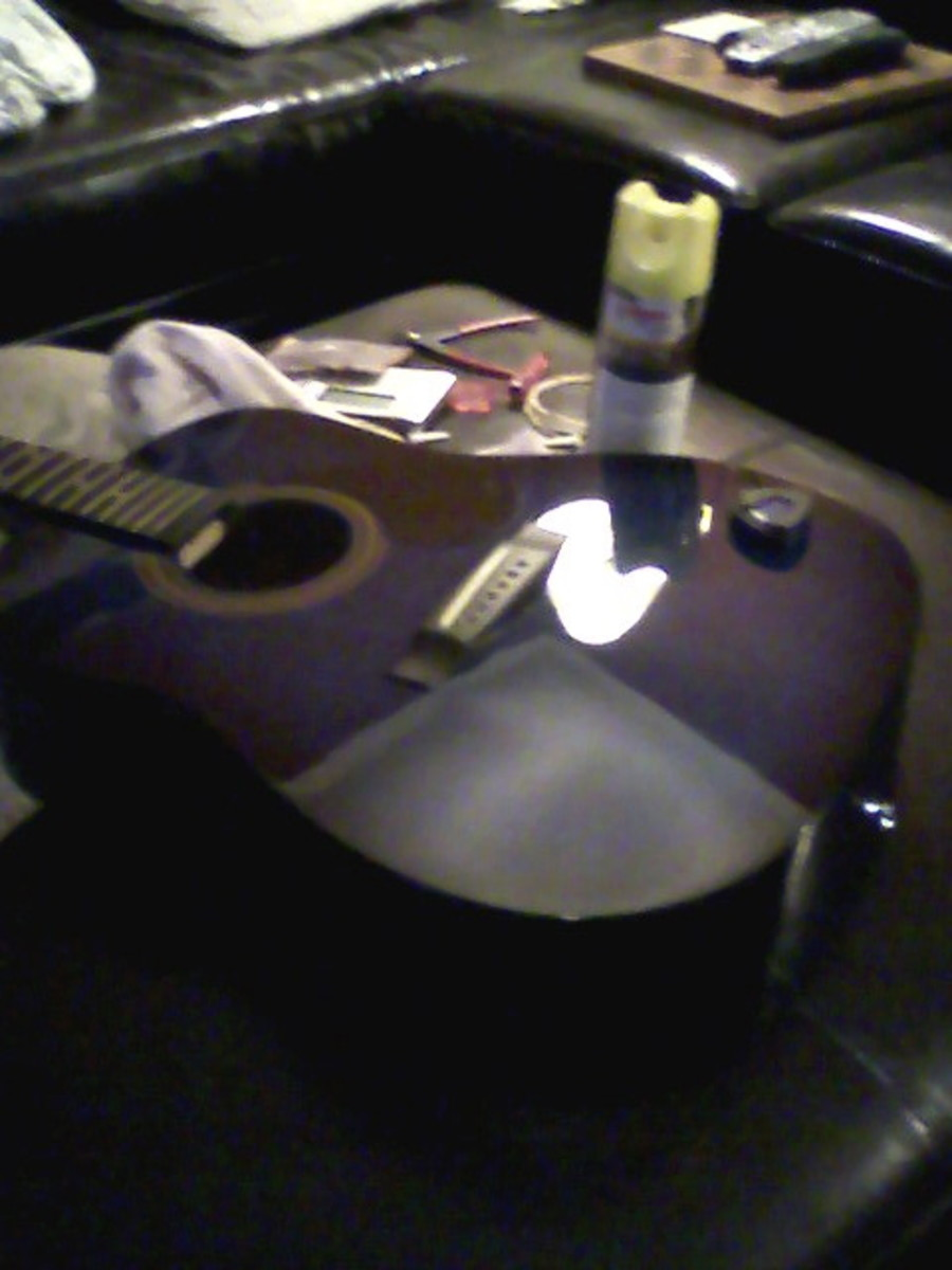 Having all strings off is a great opportunity to clean the fretboard and polish the top, as has been done here.