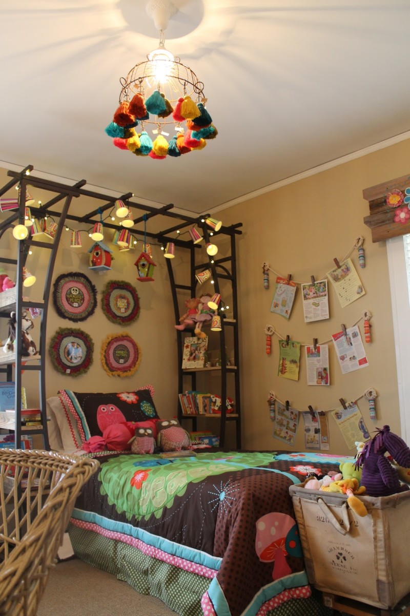 This innovative family used garden trellis for a bed canopy, creating fitted shelves with small wooden boards. Clever!