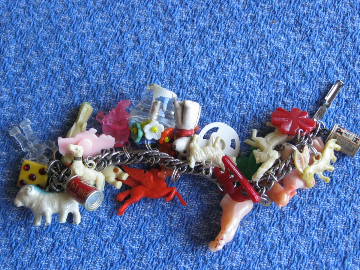 So personal and fun to wear vintage celluloid & plastic prize charms