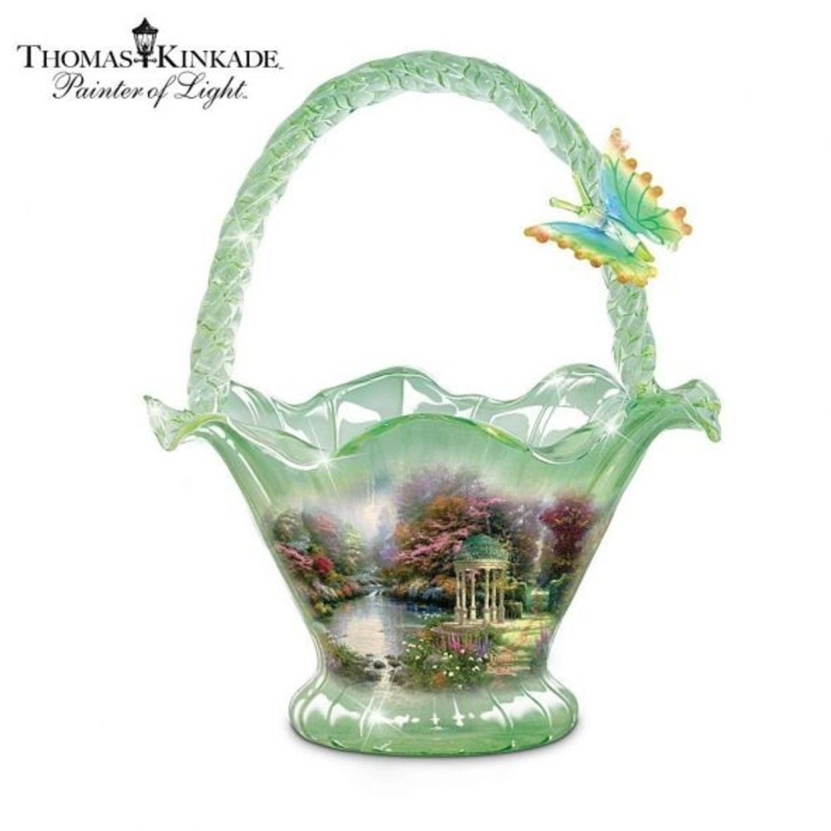 The Kinkade Garden designs are on decorative items such as this hand-blown basket.