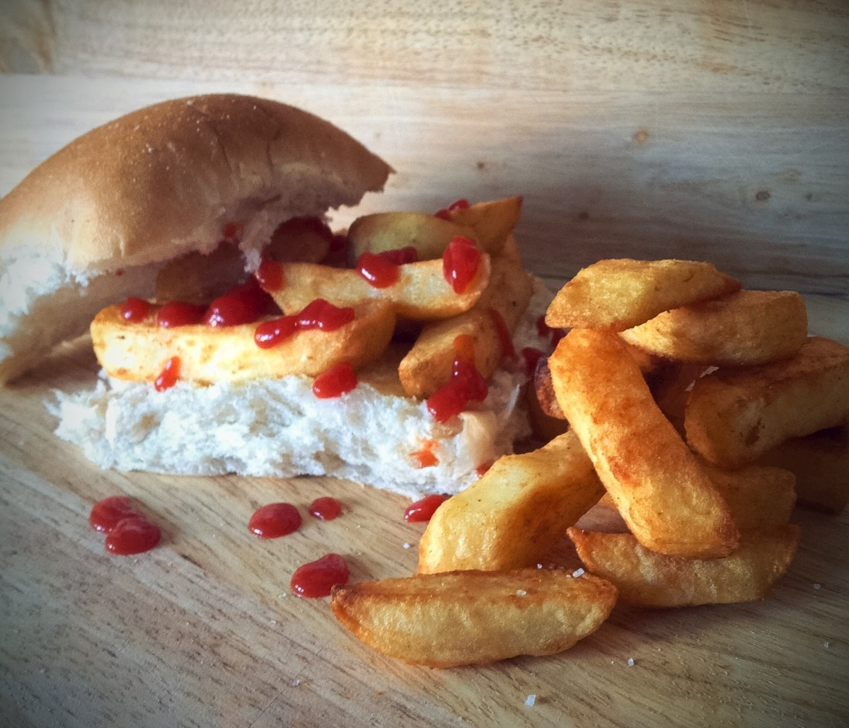 A traditional chip butty with white bread, tomato sauce, and extra chips