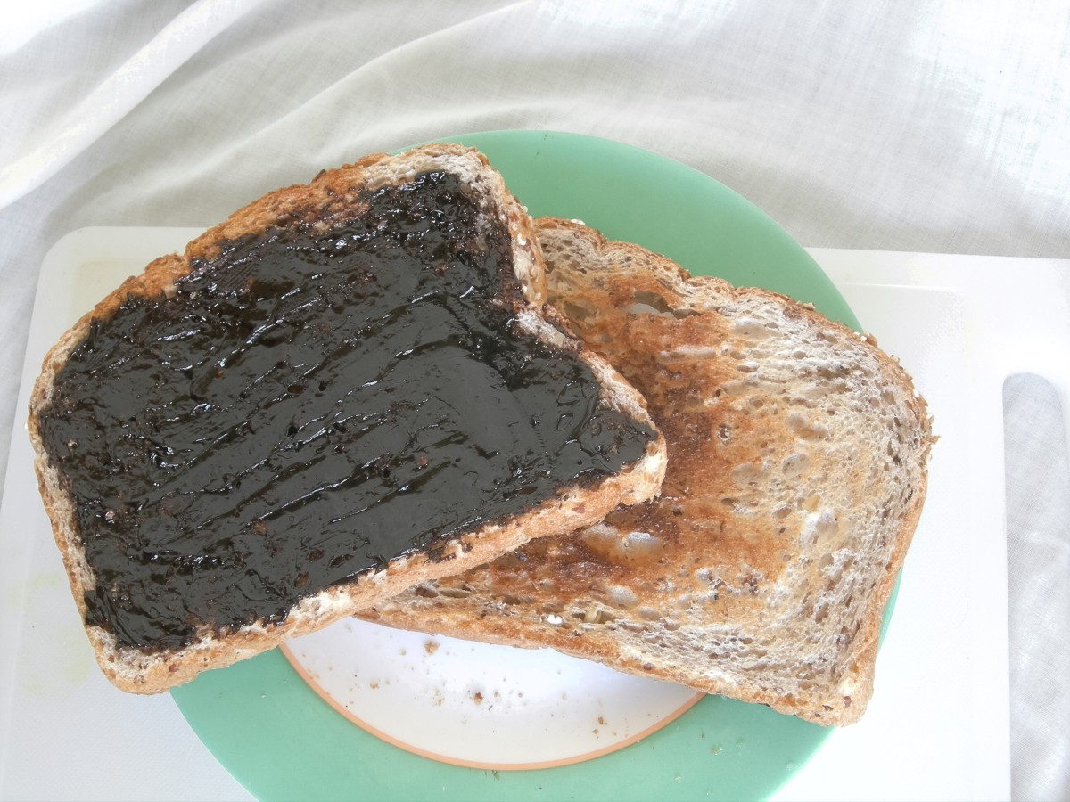 Thickly-spread marmite on toast; I love marmite, but I would never spread it this thick! I like it when patches of butter, margarine or other spread are showing in between patches of marmite.