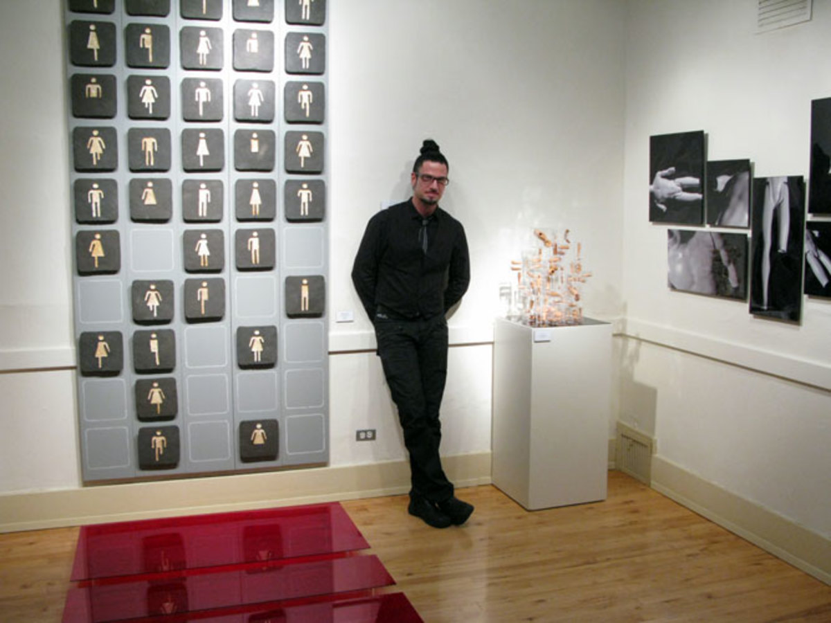 Troy Gua himself, surrounded by his installation 'Monument'