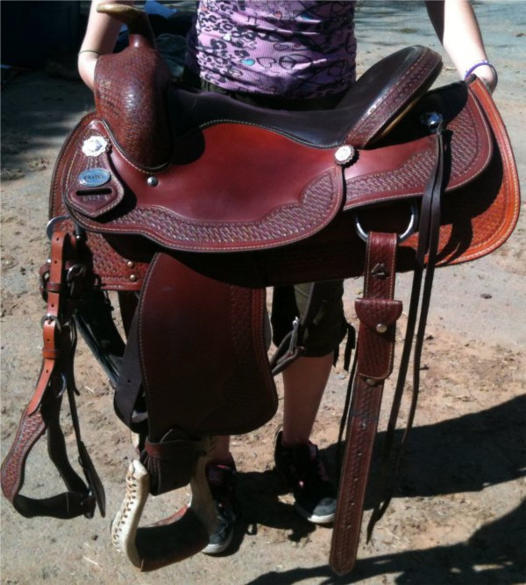 With all of these straps and stirrups dangling, I'm certain to trip on one walking this saddle to the horse.