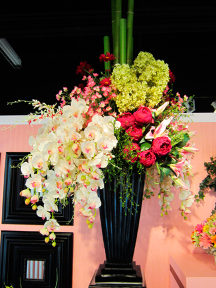 Professionals know how to clean artificial flowers and use the commercial cleaners in their showrooms and just before trade shows.