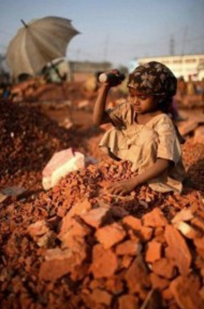 young girl working in brick factory