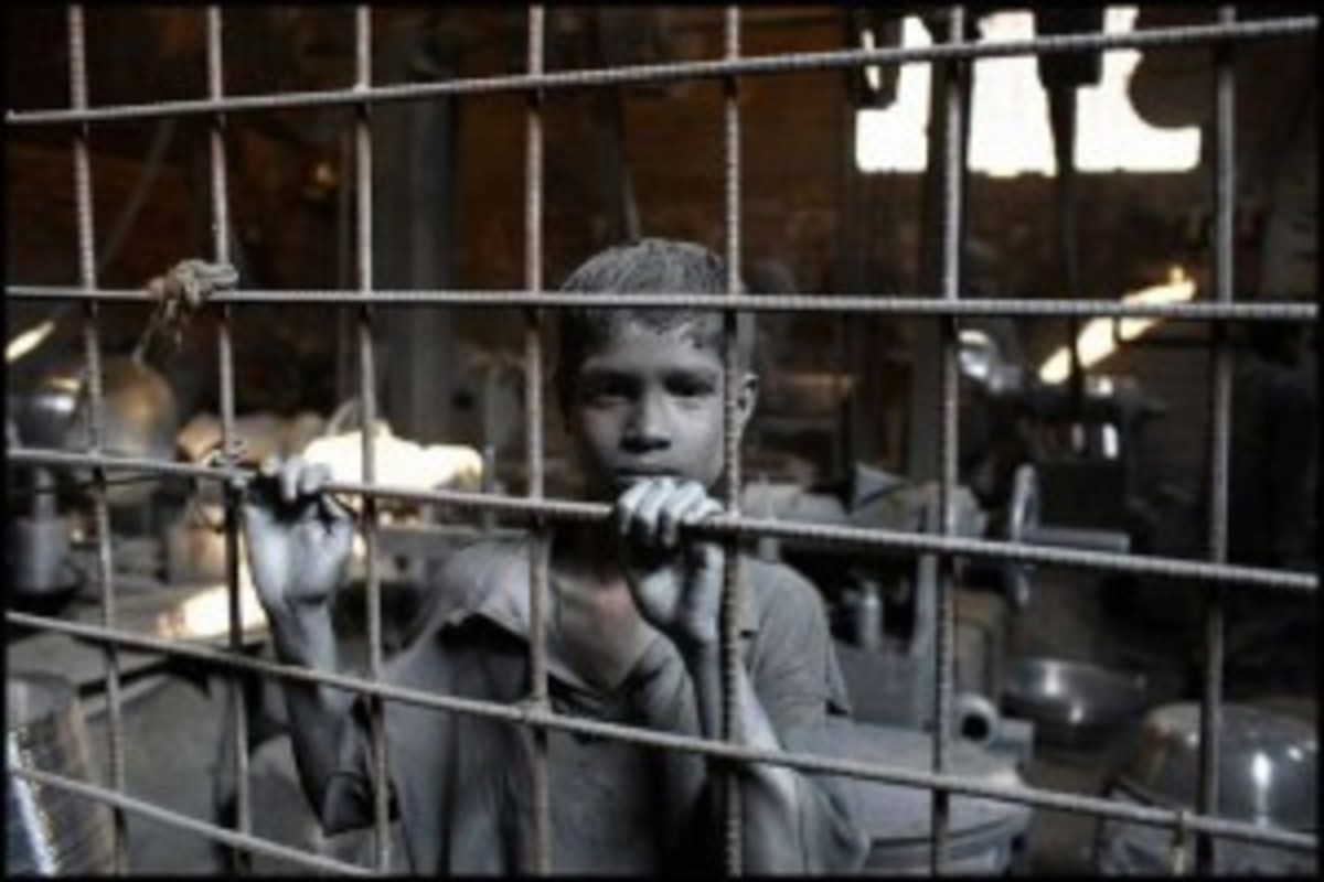 11 year old boy working in silver pot factory