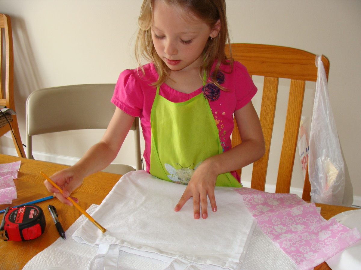 Grace spreads the fabric glue on the bag.