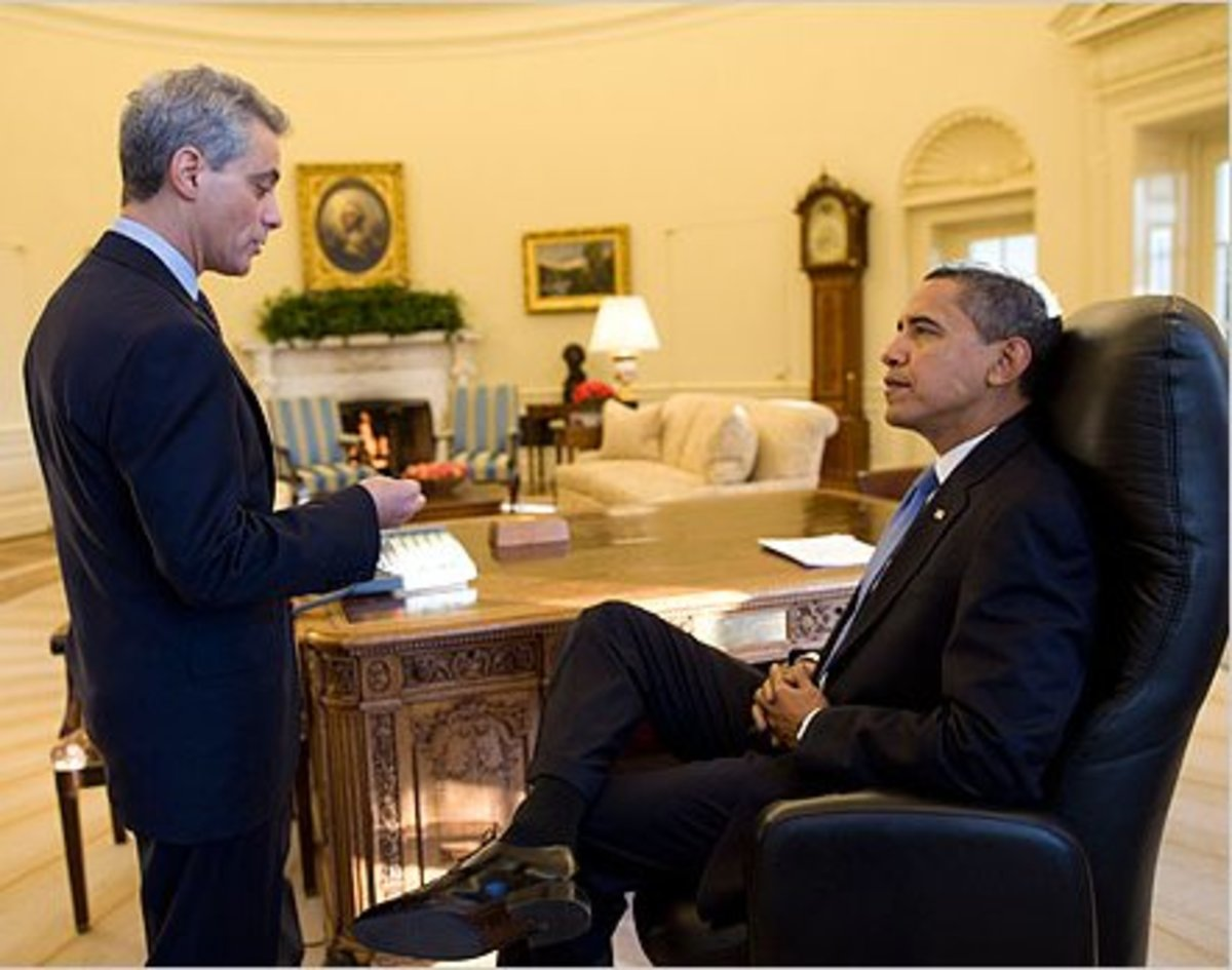 Notice Obama's calm and relaxed posture. As he leans back in his chair, his body language shows that he is in control.