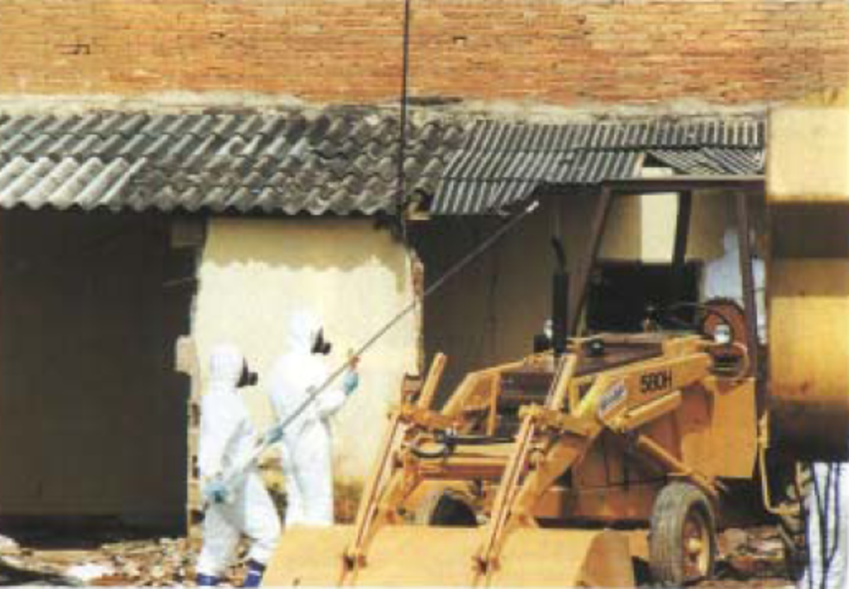 Demolishing one of the contaminated houses.