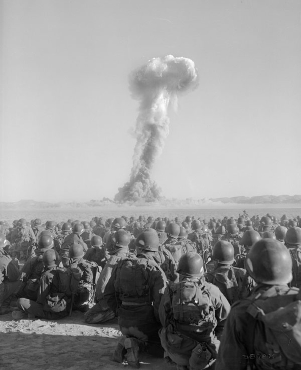 "Troops of the Battalion Combat Team, U.S. Army 11th Airborne Division, watch a nuclear blast on Yucca Flats as part of the exercise ""Desert Rock I,"" November 1, 1951."