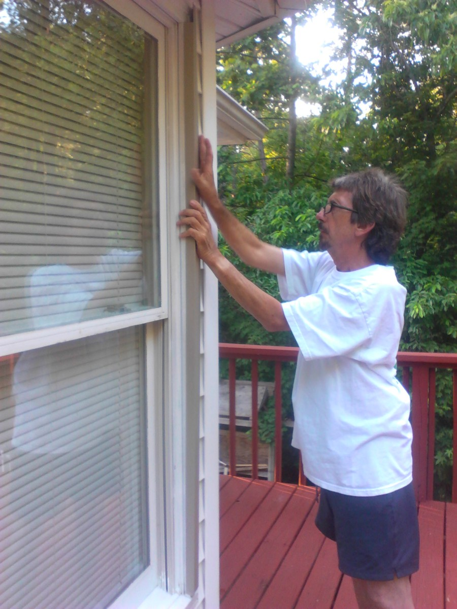 gently work metal onto molding, allowing metal to go between brick molding and window J molding.
