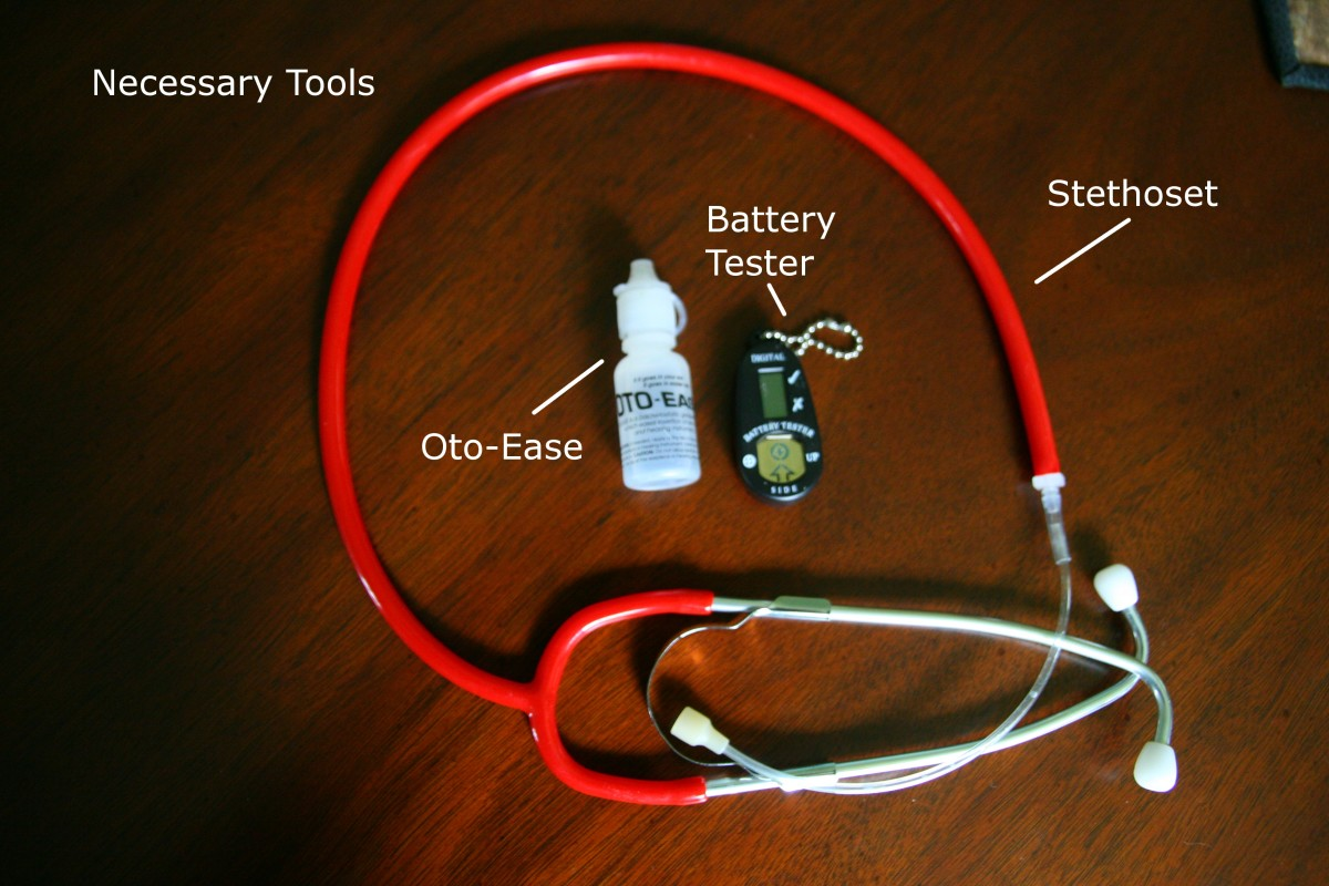 A stethoset, battery tester, and some lubricant (like Oto-Ease) are helpful tools when putting in a child's hearing aids.