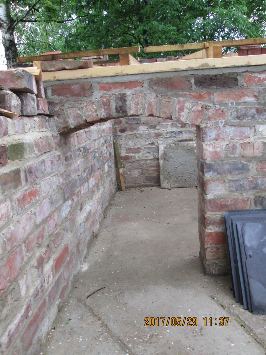 """Here piggy!"" A stylishly constructed archway to the porkers' des. res. accommodation. The roof will be slate-covered"