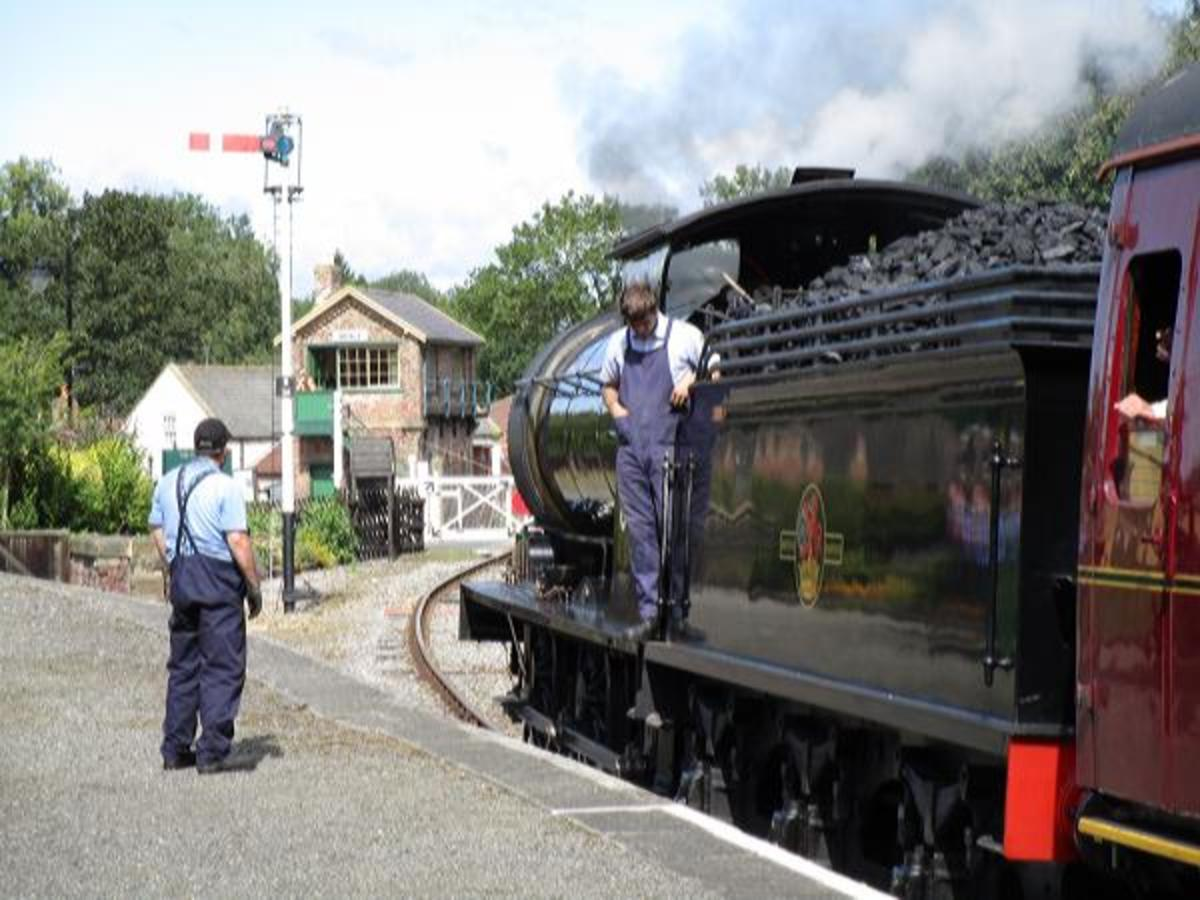 Headed for Redmire again, 65894 waits for the signalman at the crossing cabin to pull off the down starter