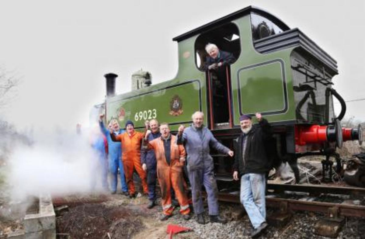 Members of the North Eastern Locomotive Preservation Group (NELPG) rest beside J72 69023 'Joem' for a group shot - loco was among last batch built to Wilson Worsdell's drawings of the 1890s - currently undergoing work at Hopetown