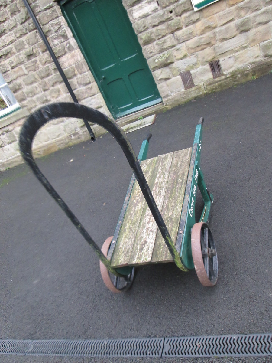 One of two platform luggage barrows that provide atmosphere for passengers awaiting their train from Redmire or Constable Burton