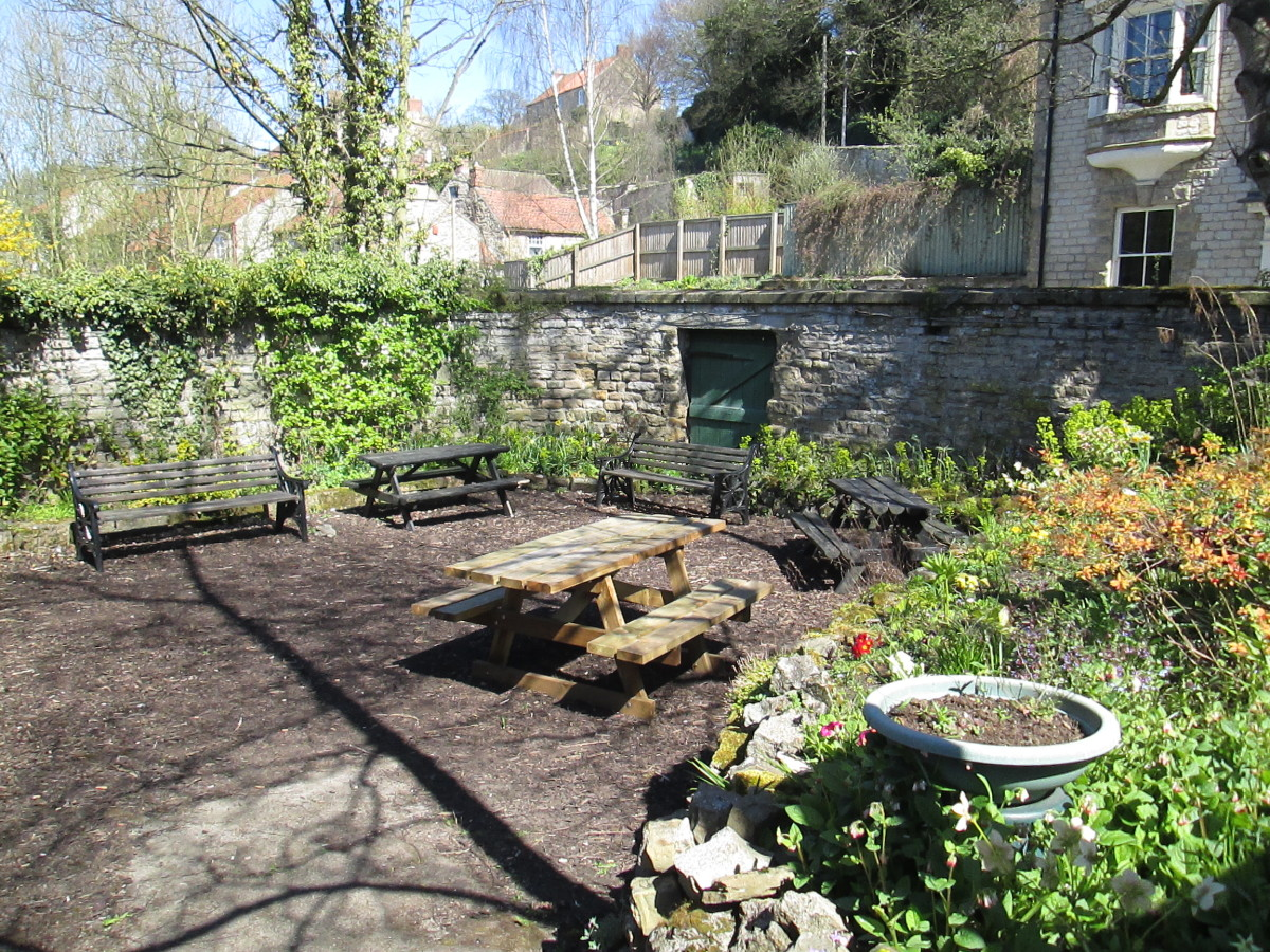 Behind the 'up' platform you'll find this peaceful little garden with benches to get away from it all - located near the porter's hut above