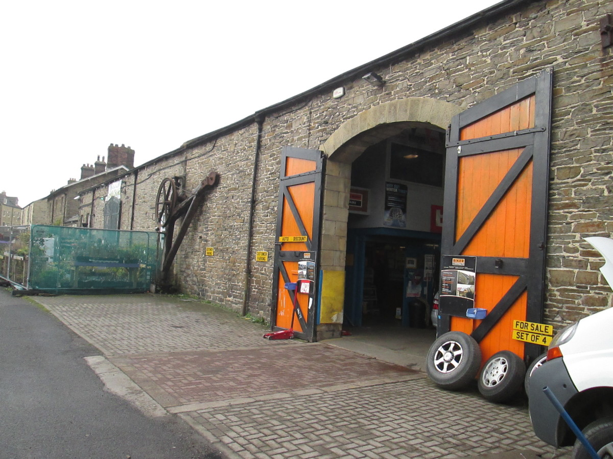 What was once one of the doorways to the goods shed now gives access to a motor workshop. The other one (left) leads to a garden centre